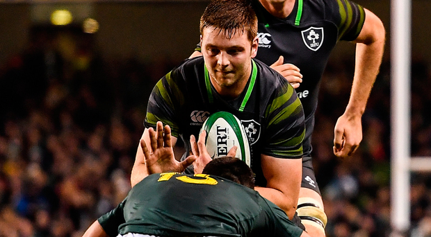 Iain Henderson is tackled by Damian de Allende. Photo: Sportsfile