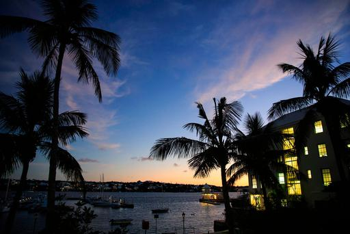 IN THE SHADOWS: A view of Hamilton Harbour in Bermuda at dusk last week. Money from the Queen's private fund is said to have been paid into an offshore fund on the British island territory. Picture: Getty