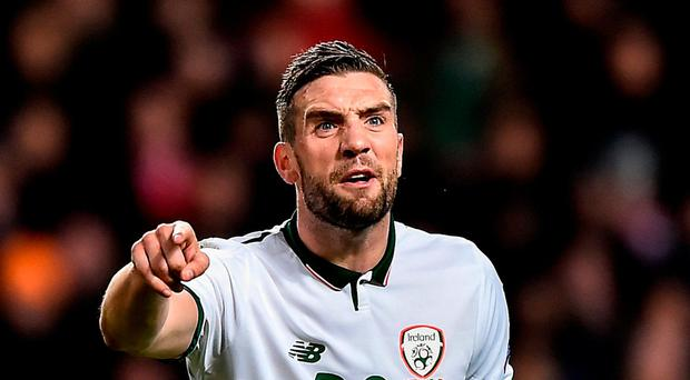 Shane Duffy of Republic of Ireland signals to a teammate during the FIFA 2018 World Cup Qualifier Play-off 1st Leg match between Denmark and Republic of Ireland at Parken Stadium in Copenhagen, Denmark. Photo by Seb Daly/Sportsfile