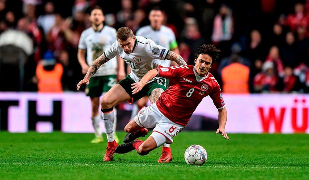 Thomas Delaney of Denmark is fouled by James McClean of Republic of Ireland during the FIFA 2018 World Cup Qualifier Play-off 1st Leg match between Denmark and Republic of Ireland at Parken Stadium in Copenhagen, Denmark. Photo by Seb Daly/Sportsfile