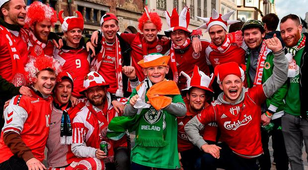 Young Republic of Ireland supporter Eoin O'Neill, from Tallaght, Dublin, with Denmark supporters in Copenhagen prior to the FIFA 2018 World Cup Qualifier Play-off 1st Leg match between Denmark and Republic of Ireland at Parken Stadium in Copenhagen, Denmark. Photo by Seb Daly/Sportsfile