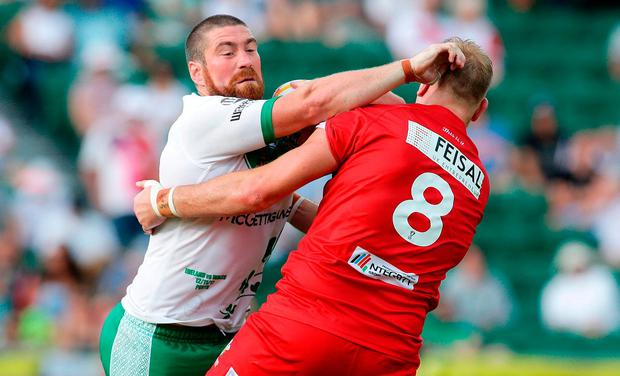 Kyle Amor of Ireland fends off Craig Kopczak of Wales during the 2017 Rugby League World Cup match between Wales and Ireland at nib Stadium in Perth, Australia. (Photo by Will Russell/Getty Images)