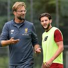 Adam Lallana is currently out injured but is expected back in November Getty