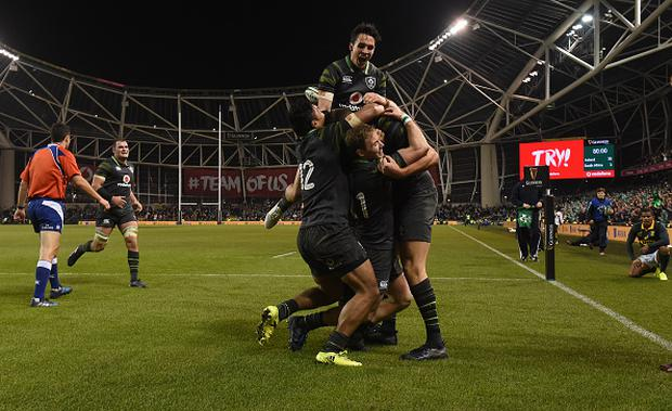 Joey Carbery, Sean O'Brien, Bundee Aki and Andrew Conway congratulate Jacob Stockdale of Ireland after scoring his side's fourth try during the Guinness Series International match between Ireland and South Africa at the Aviva Stadium in Dublin. (Photo By Matt Browne/Sportsfile via Getty Images)