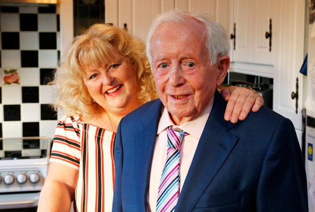 Teena Gates with her father Terry Martin at their Clonsilla home yesterday. Photo: Colin O'Riordan