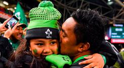 Bundee Aki celebrates with his daughter Adrianna (6) after Ireland's victory over South Africa at the Aviva Stadium. Photo: Brendan Moran/Sportsfile