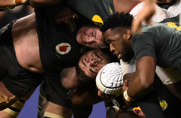 The intricacies of the scrum are caught on camera as Tadhg Furlong (L) does battle with South Africa's Malcolm Marx and Siya Kolisi. Photo: Reuters