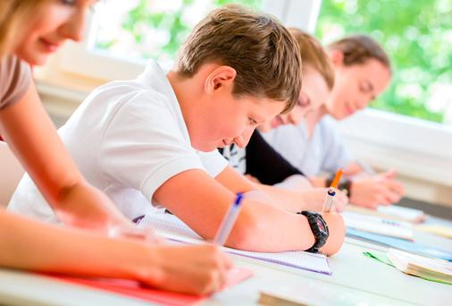 Pupils should get 240 hours of maths over three years. Stock Image
