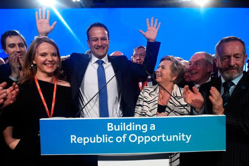 Taoiseach Leo Varadkar waves on stage with colleagues after his opening address of the Fine Gael national party conference in Ballyconnell, Ireland. Photo: REUTERS/Clodagh Kilcoyne