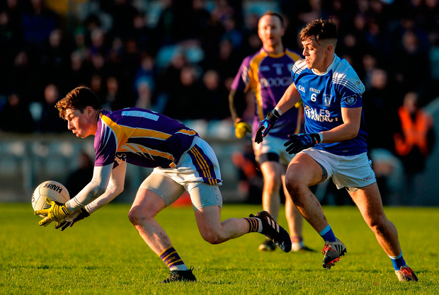Gary McKenna of Derrygonnelly Harps in action against Barry Fortune of Cavan Gaels Photo: Oliver McVeigh/Sportsfile