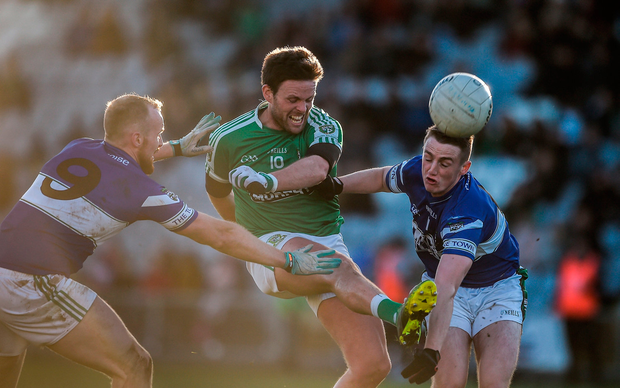 Cian O'Connor of Moorefield in action against Ciarán McEvoy, left, and Brendan Carroll of Portlaoise Photo: Daire Brennan/Sportsfile