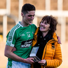 Moorefield forward Éanna O'Connor is congratulated by his mother Bridie after accepting his man of the match award in O'Moore Park yesterday Photo: Daire Brennan/Sportsfile