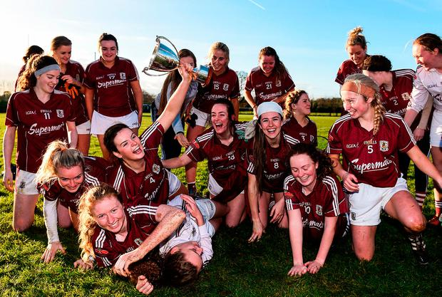 The Galway team celebrate with the Aisling McGing Memorial Cup Photo: Sam Barnes/Sportsfile