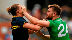 Nat Fyfe of Australia and Aidan O Shea tussle during the opening Test in Adelaide Photo: Ray McManus/Sportsfile