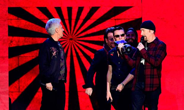U2 on stage during the MTV Europe Music Awards 2017 held at The SSE Arena, London. PRESS ASSOCIATION Photo. Picture date: Sunday November 12, 2017. Photo credit should read: Ian West/PA Wire