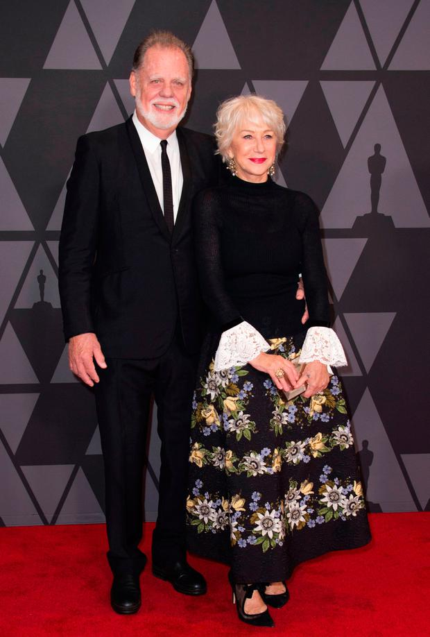 Director Taylor Hackford (L) and Actress Helen Mirren attend the 2017 Governors Awards, on November 11, 2017, in Hollywood, California. / AFP PHOTO / VALERIE MACONVALERIE MACON/AFP/Getty Images