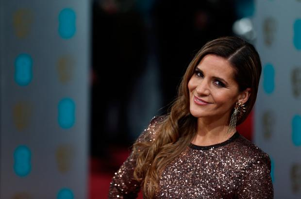 Irish television presenter Amanda Byram poses on the red carpet upon arrival to attend the annual BAFTA British Academy Film Awards at the Royal Opera House in London on February 10, 2013. AFP PHOTO/ANDREW COWIE