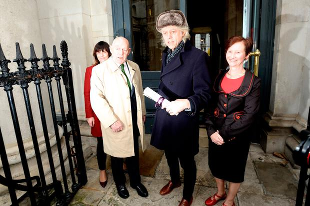 Bob Geldof returns his Freedom of Dublin city scroll to City Hall Dublin today along side Gerard Mannix Flynn. Pic: Justin Farrelly.