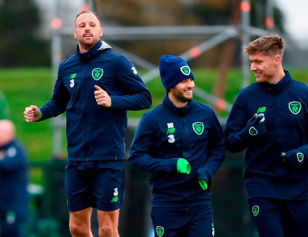 David Meyler (left) warms up during training in Abbotstown alongside Wes Hoolahan and Jeff Hendrick. Photo by Stephen McCarthy/Sportsfile