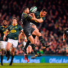 Rob Kearney competes for the dropping ball with South Africa's Jesse Kriel. Photo by Brendan Moran/Sportsfile