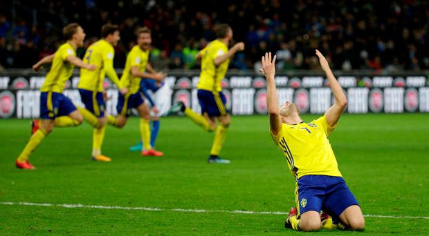 Sweden's Sebastian Larsson and teammates celebrate after the match. REUTERS/Max Rossi