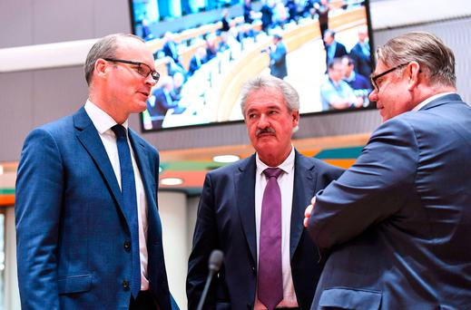Foreign Minister Simon Coveney (L), Luxembourg's Foreign Minister Jean Asselborn (C) and Finland's Foreign Minister Timo Soini attend a foreign affairs council at the European Council in Brussels. Photo: AFP/Getty Images