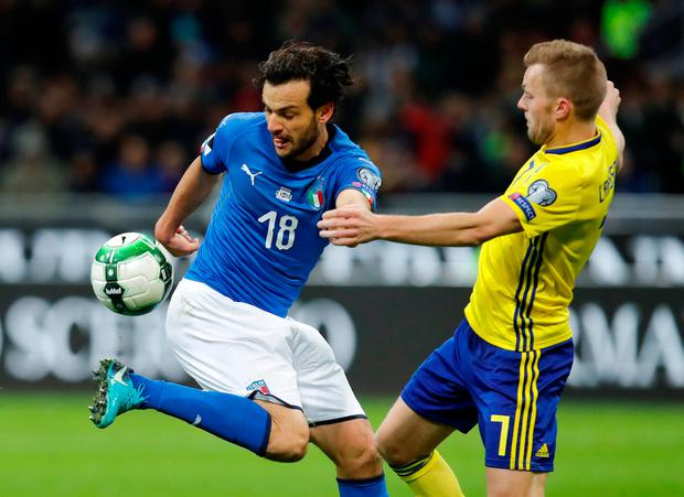 Italy's Marco Parolo in action with Sweden's Sebastian Larsson. Photo: Reuters/Alessandro Garofalo