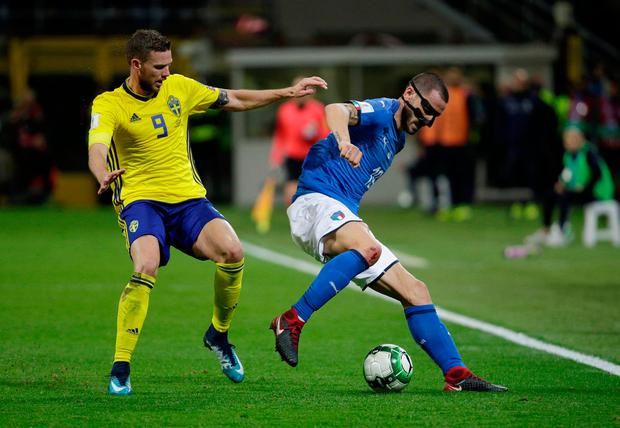 Italy's Leonardo Bonucci in action with Sweden's Marcus Berg. Photo: Reuters/Max Rossi