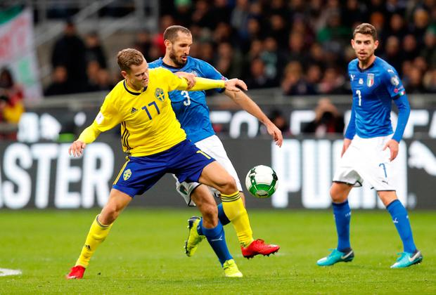 Italy's Giorgio Chiellini in action with Sweden's Viktor Claesson as Italy's Jorginho looks on. Photo: Reuters/Alessandro Garofalo