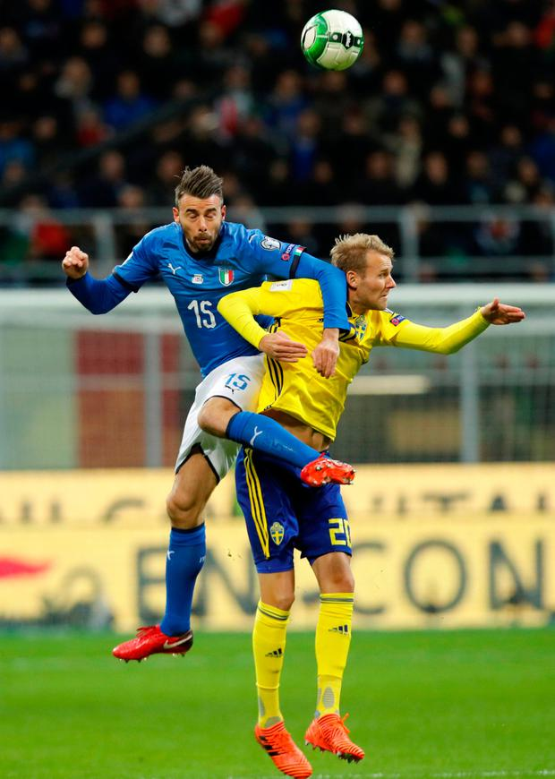 Italy's Andrea Barzagli in action with Sweden's Ola Toivonen. Photo: Reuters/Alessandro Garofalo