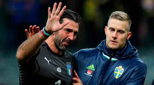 Gianluigi Buffon waves goodbye to international football after Italy's World Cup hopes were ended by play-off defeat to Sweden following a 0-0 second leg draw. Photo by Marco Luzzani/Getty Images