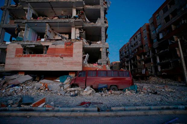 A damaged van and buildings are seen following a 7.3-magnitude earthquake at Sarpol-e Zahab in Iran's Kermanshah province on November 13, 2017. / AFP PHOTO / ISNA / POURIA PAKIZEHPOURIA PAKIZEH/AFP/Getty Images