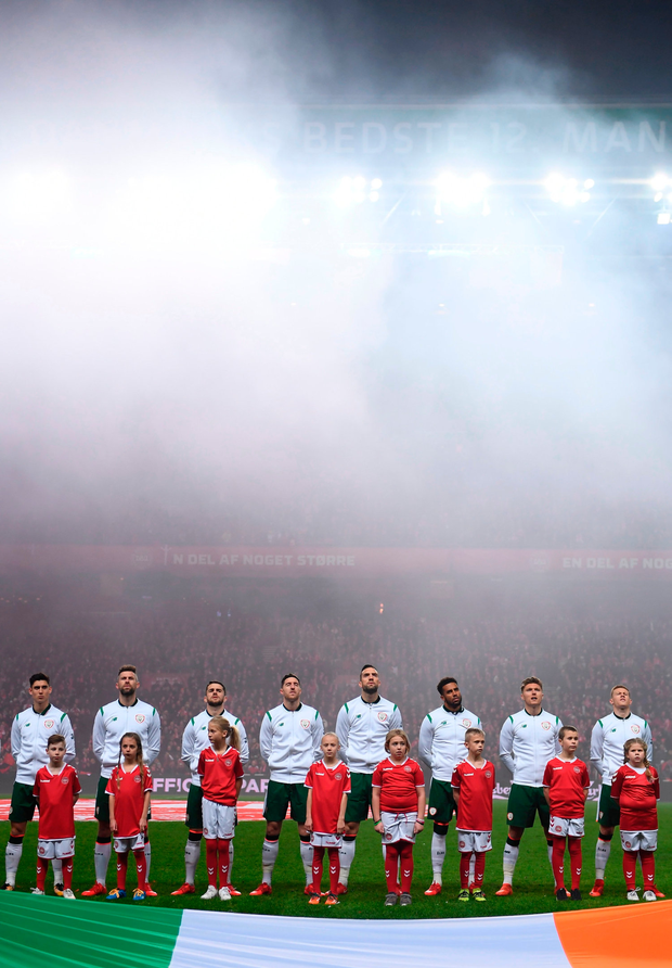 Ireland players stand for the national anthem in Denmark