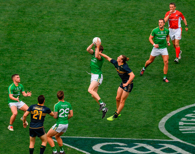 Kildare's Kevin Feely soars into the air to win possession ahead of Australia's Nat Fyfe during the first Test at the Adelaide Oval on Saturday. Photo: Ray McManus/Sportsfile