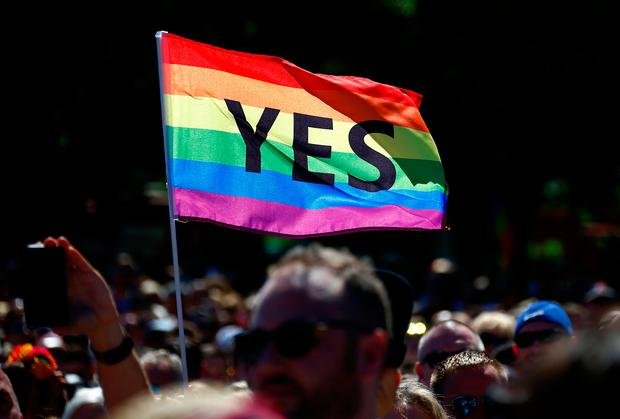 Supporters of the 'Yes' vote for marriage equality celebrate after it was announced the majority of Australians support same-sex marriage in a national survey, paving the way for legislation to make the country the 26th nation to formalise the unions by the end of the year, at a rally in central Sydney, Australia, November 15, 2017. REUTERS/David Gray