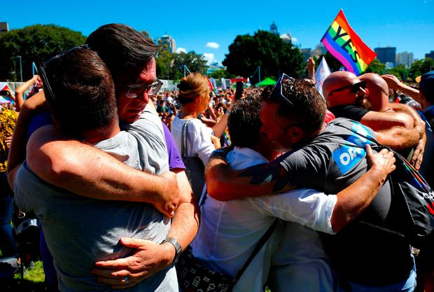 People celebrate after it was announced the majority of Australians support same-sex marriage in a national survey, paving the way for legislation to make the country the 26th nation to formalise the unions by the end of the year, at a rally in central Sydney, Australia, November 15, 2017. REUTERS/David Gray