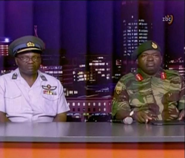 Zimbabwe Defence Forces Major-General SB Moyo (R) makes an announcement on state broadcaster ZBC, in this still image taken from a November 15, 2017 video. ZBC/Handout via REUTERS