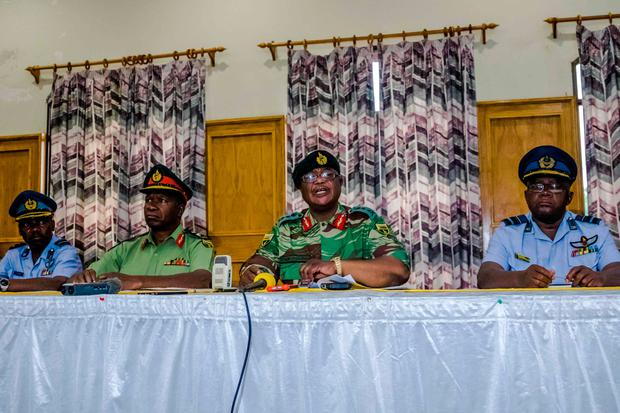 Zimbabwe Army General Constantino Chiwenga Commander of the Zimbabwe Defence Forces (C,R) and Valerio Sibanda Commander of the Zimbabwe National Army (C,L) address a media conference held at the Zimbabwean Army Headquarters on November 13, 2017 in Harare./ AFP PHOTO / Jekesai NJIKIZANAJEKESAI NJIKIZANA/AFP/Getty Images