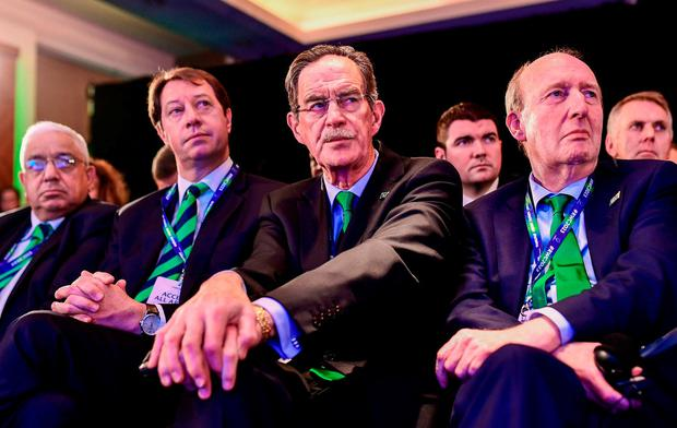 Ireland 2023 Oversight Board chairman Dick Spring, and Minister for Transport, Tourism and Sport Shane Ross, T.D., right, react during the Rugby World Cup 2023 host union announcement at the Royal Garden Hotel, London, England. Photo by Alex Broadway / World Rugby via Sportsfile