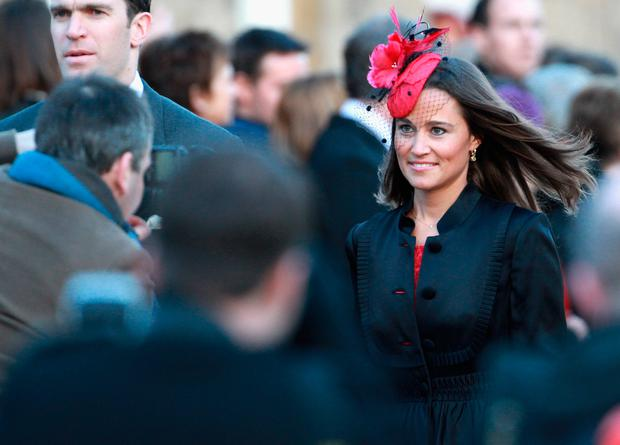 Pippa Middleton attends the wedding of Katie Percy to Patrick Valentine at St Michael's Church in Alnwick, Northumberland on February 26, 2011 in Alnwick, England