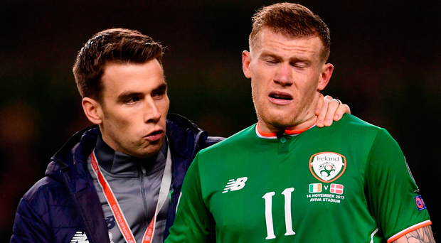 Seamus Coleman consoles James McClean after Ireland's defeat. Photo: Sportsfile