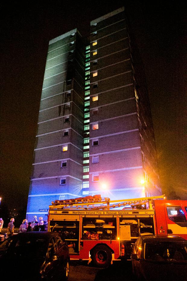 Emergency services at the scene of a fire at Coolmoyne House in Dunmurry, near Belfast, where residents have been evacuated from the building. PRESS ASSOCIATION Photo.
