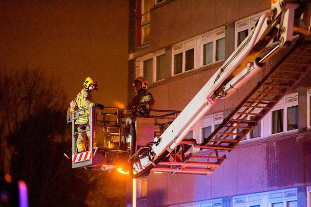 Firefighters at the scene of a fire at Coolmoyne House in Dunmurry, near Belfast, where residents have been evacuated from the building. PRESS ASSOCIATION Photo.