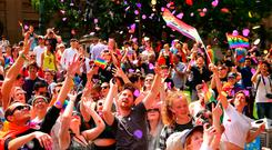 Crowds celebrate in Melbourne as the results of the Australian marriage equality vote are announced. Photo: Scott Barbour/Getty Images
