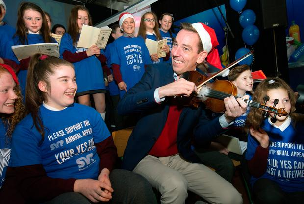 Ryan Tubridy with children from St Margaret's School Choir, Dublin, at the launch of the St Vincent de Paul Annual Appeal at its HQ in Sean McDermott Street, Dublin. Photo: Tony Gavin