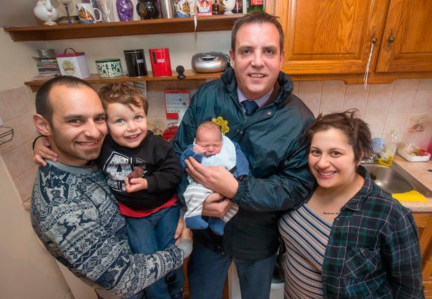Baby Ryan Shane pictured with Detective Garda Shane Elliffe, his parents Andrea and Nadia and brother Alessio. Photo: Pat Moore