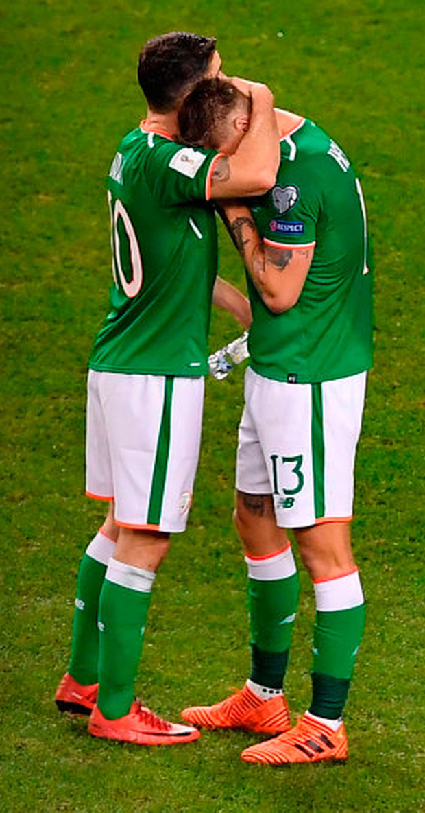 A dejected Robbie Brady consoles team-mate Jeff Hendrick (r) after the Republic of Ireland's World Cup qualifier play-off defeat to Denmark at the Aviva Stadium on Tuesday. Photo: Brendan Moran/Sportsfile