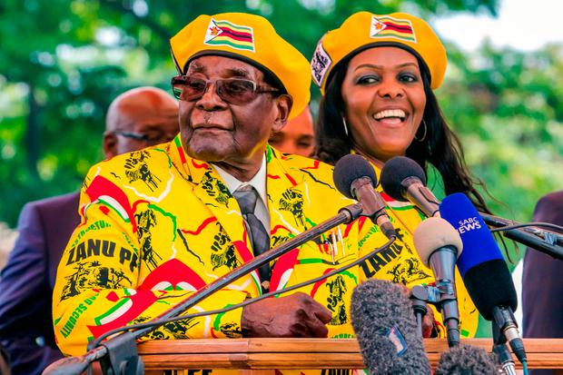 Zimbabwe President Robert Mugabe addressing party members with his wife Grace earlier this month. Photo: Getty Images