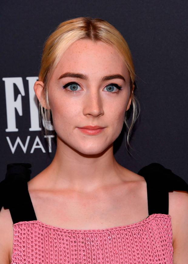 Actress Saoirse Ronan attends the Hollywood Foreign Press Association (HFPA) and InStyle celebration of the 75th Annual Golden Globe Awards season at Catch LA in West Hollywood, on November 15, 2017. / AFP PHOTO / CHRIS DELMASCHRIS DELMAS/AFP/Getty Images