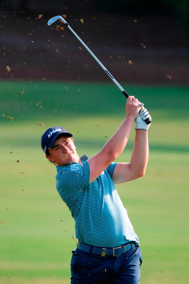 Paul Dunne of Ireland hits his third shot on the 18th